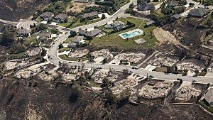Homes destroyed by the Sleepy Hollow fire are pictured in Wenatchee, Washington June 29, 2015. REUTERS/David Ryder